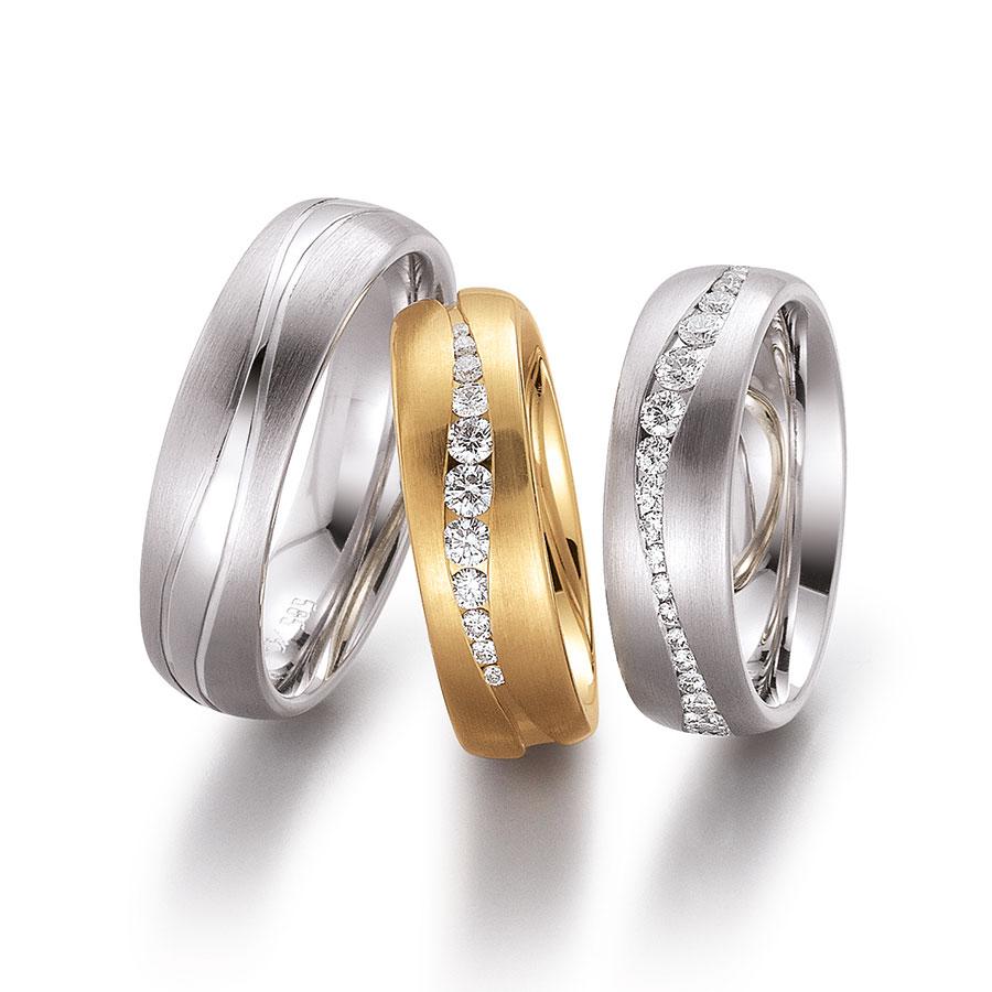 Massive Gerstner Trauringe mit schwungvoller Diamant-Intarsie | Juwelier Wieland München